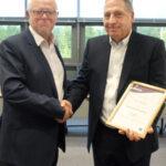 Simon Hollingbury receives BICSc Fellowship from Stan Atkins